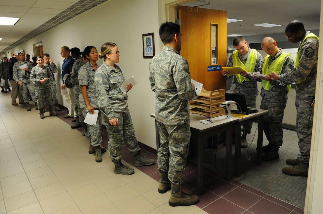 Keesler personnel follow hurricane shelter in-processing procedures at Wolfe Hall during a hurricane exercise Aug. 5, 2016, on Keesler Air Force Base, Miss. The purpose of the exercise was to prepare Keesler for the current hurricane season. (U.S. Air Force photo by Kemberly Groue/Released)