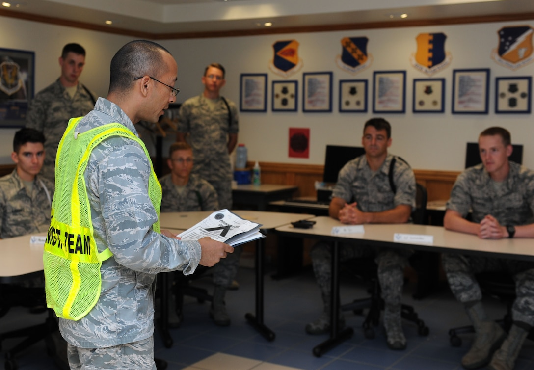 Capt. Santiago Camacho, 335th Training Squadron director of operations and shelter management team member, brief non-prior service Airmen on hurricane shelter in-processing procedures at Allee Hall during a hurricane exercise Aug. 5, 2016, on Keesler Air Force Base, Miss. The purpose of the exercise was to prepare Keesler for the current hurricane season. (U.S. Air Force photo by Kemberly Groue/Released)