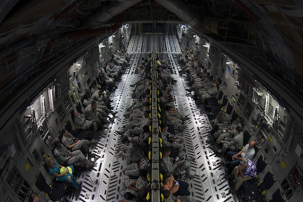Airmen and civilians assigned to Keesler Air Force Base, Miss., participate in an incentive flight aboard a C-17 Globemaster III from Altus Air Force Base, Okla., Aug. 4, 2016. The incentive flight was part of a weeklong hurricane exercise to prepare Keesler for the current hurricane season. (U.S. Air Force photo by Senior Airman Duncan McElroy/Released)