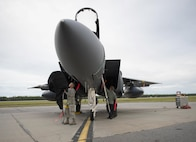 U.S. Air Force Airmen 1st Class Jordan Baker and Timothy Rich, both assigned to the 336th Aircraft Maintenance Unit, Seymour Johnson Air Force Base, N.C., remove a cover from a U.S. Air Force F-15E Strike Eagle fighter aircraft Aug. 5, 2016, at Eielson Air Force Base, Alaska, prior to the familiarization day of RED FLAG-Alaska 16-3. This exercise provides unique opportunities to integrate various forces into joint, coalition and multilateral training from simulated forward operating bases. (U.S. Air Force photo by Staff Sgt. Shawn Nickel)