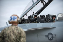 U.S. Navy pilots and a crew chief assigned to the Electronic Attack Squadron 135, Naval Air Station Whidbey Island, Wash., prepare an EA-18G Growler aircraft for take off, Aug. 5, 2016, at Eielson Air Force Base, Alaska, during the familiarization day of RED FLAG-Alaska (RF-A) 16-3.  Free exchange of ideas between multilateral forces during RF-A enhances not just partners and sister-service relationships, but also their operational efficiency. (U.S. Air Force photo by Staff Sgt. Shawn Nickel)