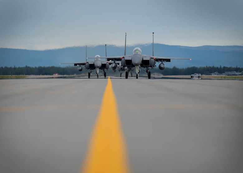 U.S. Air Force F-15E Strike Eagles dual-role fighter aircraft assigned to the 336th Fighter Squadron, Seymour Johnson Air Force Base, N.C., taxi for take off Aug. 5, 2016, at Eielson Air Force Base, Alaska, during familiarization day of RED FLAG-Alaska 16-3. This exercise provides unique opportunities to integrate various forces into joint, coalition and multilateral training from simulated forward operating bases. (U.S. Air Force photo by Staff Sgt. Shawn Nickel)