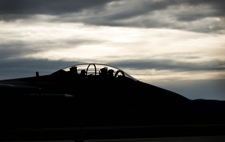 A U.S. Air Force F-15E Strike Eagle dual-role fighter aircraft assigned to the 336th Fighter Squadron, Seymour Johnson Air Force Base, N.C., prepares to take off Aug. 5, 2016, from Eielson Air Force Base, Alaska, during familiarization day of RED FLAG-Alaska (RF-A) 16-3. Originally operated under the name COPE THUNDER, the exercise moved to Eielson in 1992 from Clark Air Base, Philippines, after the eruption of Mount Pinatubo on June 15, 1991. COPE THUNDER was re-designated RF-A in 2006. (U.S. Air Force photo by Staff Sgt. Shawn Nickel)