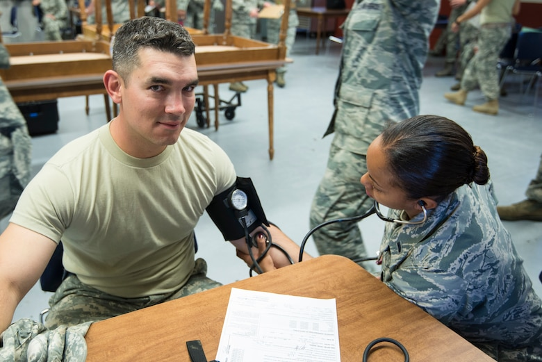 1st Lt. Isis Rojas-Scott, a nurse assigned to the 140th Medical Group, Buckley Air Force Base, takes blood pressure of Soldiers and Airmen participating in the joint exercise evaluation (EXEVAL), where they will be evaluated for war time readiness at Camp Rilea in Warrenton, Oregon, on Aug.2, 2016. The EXEVAL ran for five days in a crawl, walk, run sequence, where they started off slow then transitioned into rapid response on evaluation day. (U.S. Air National Guard photo by Staff Sgt. Bobbie Reynolds)