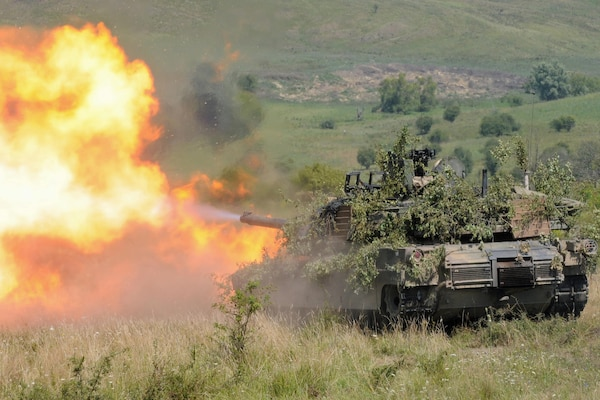 An Abrams tank fires a round during the multinational exercise Saber Guardian 16 near Cincu, Romania, Aug. 6, 2016. The tank belongs to Delta Company, 1st Combined Arms Battalion, 64th Armor Regiment, 1st Armored Brigade Combat Team, 3rd Infantry Division.