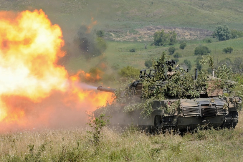 An Abrams tank fires a round during the multinational exercise Saber Guardian 16 near Cincu, Romania, Aug. 6, 2016. The tank belongs to Delta Company, 1st Combined Arms Battalion, 64th Armor Regiment, 1st Armored Brigade Combat Team, 3rd Infantry Division. Approximately 2800 military personnel from 10 nations are taking part in Saber Guardian. Army photo by Staff Sgt. Corinna Baltos