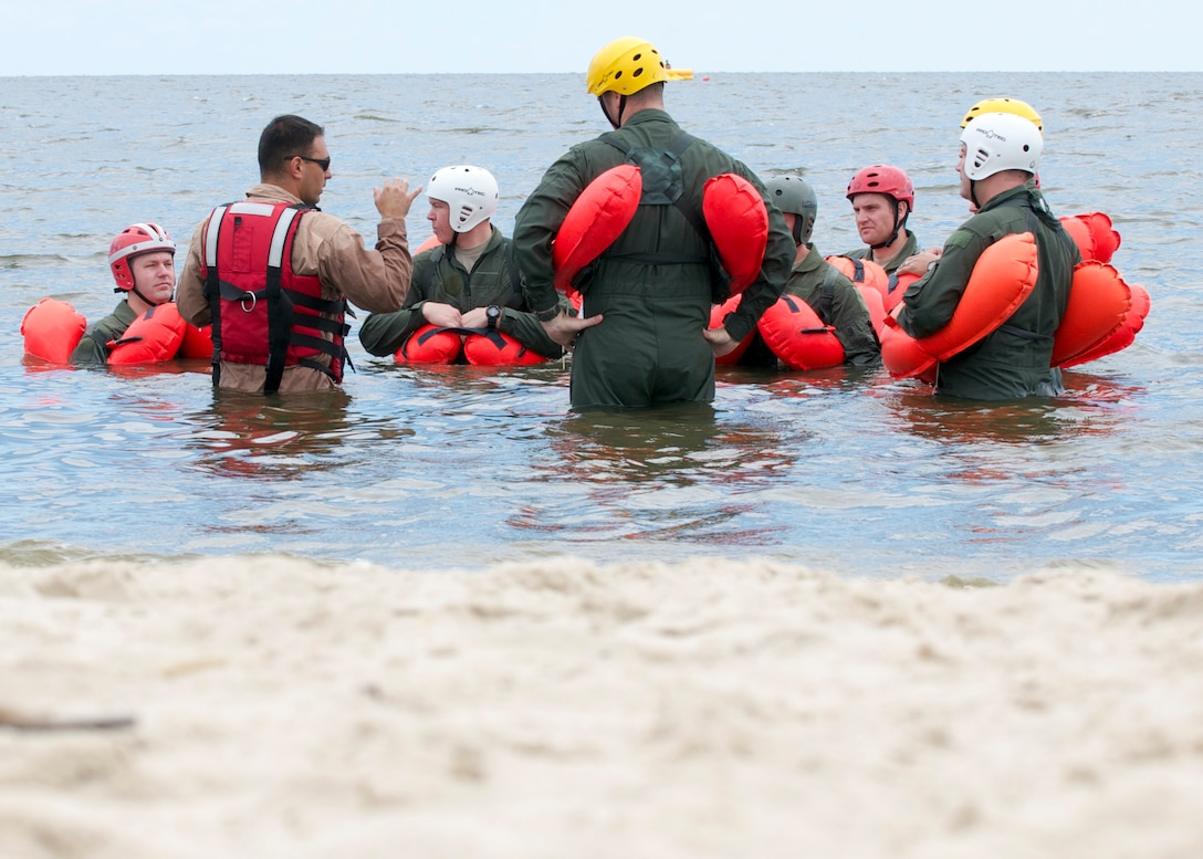 Tech. Sgt. Joseph Monreal, 436th Operations Support Squadron, instructs water survival training to Airmen with the 436th and 512th Airlift Wings Aug. 5, 2016, at Bowers Beach, Del. The Airmen worked on treading water, raft survival and rescue via helicopter basket. (U.S. Air Force Photo/ Staff Sgt. Tiffany Lindemann)