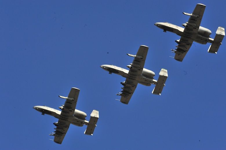 Three A-10 Thunderbolt IIs assigned to the 25th Fighter Squadron perform a flyover during Air Power Day 2011 at Osan Air Base, Republic of Korea. Air Power Day 2016 will include performances from A-10s and F-16 Flying Falcons assigned to Osan in additions to multiple other acts and static displays. (U.S. Air Force courtesy photo/released)
