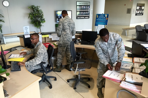 Senior Airman Christopher Casey (left), Staff Sgt. Torrey Miller (center), and Senior Airman Calvin Fleming prepare for patients at the Joint Base Langley-Eustis, Va., clinic Aug. 6, 2016. The Airmen are health services management technicians for the 920th Aerospace Medicine Squadron, a geographically separated unit of the 920th Rescue Wing at Patrick Air Force Base, Fla. (U.S. Air Force photo by 1st Lt. Anna-Marie Wyant)