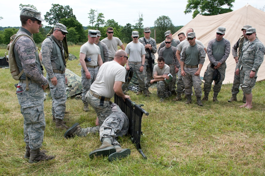 Tech. Sgt. Glenn Macher demonstrates litter techniques during the 167th Security Forces Squadron field training event in Gerrardstown, W.Va., June22. (U.S. Air National Guard photo by Senior Master Sgt. Emily Beightol-Deyerle)