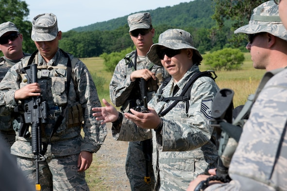 Master Sgt. Tammy Marks conducts a quick review of a training exercise with members of the 167th Security Forces Squadron during their field training event in Gerrardstown, W.Va., June 22. (U.S. Air National Guard photo by Senior Master Sgt. Emily Beightol-Deyerle)