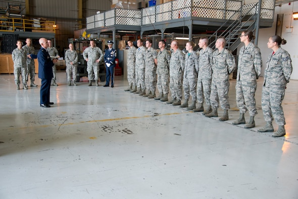Col. Shaun Perkowski, commander of the 167th Airlift Wing, addresses newly certified Honor Guard members upon their completion of a forty-hour training course at the Martinsburg air base, July 22. (U.S. Air National Guard photo by Senior Master Sgt. Emily Beightol-Deyerle)