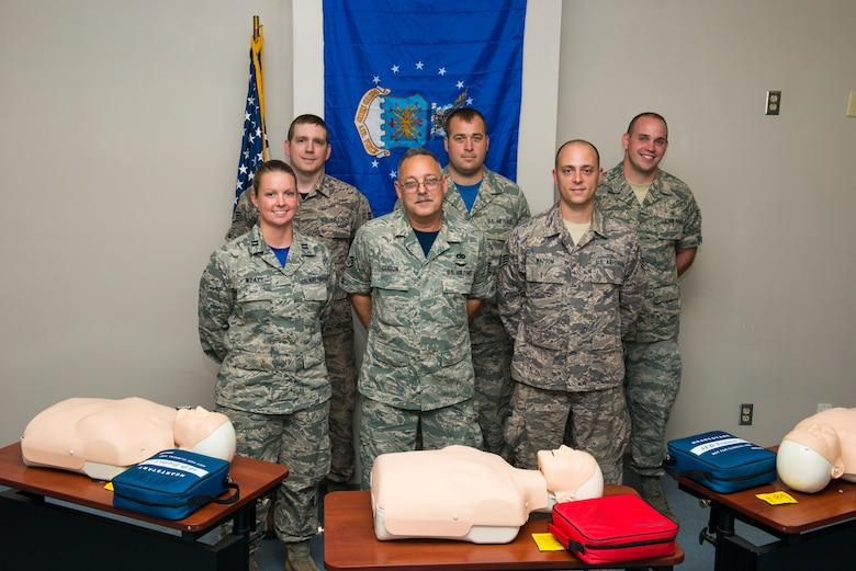 Three members of the 167th Airlift Wing in Martinsburg, W.Va., stand by instructors that taught them CPR, Aug. 6, 2016. Back L-R: Staff Sgt. Johnathen Guzik, a member of metals technology at the 167th, Staff Sgt. Justin Bird and Senior Airman Travis Sites, both CPR instructors at the 167th. Front L-R: Capt. Lori Wyatt, CPR instructor at the 167th, Staff Sgt. John Carson, a crew chief at the 167th, and Staff Sgt. Justin Watson a member of metals technology at the 167th. Guzik, Carson and Watson performed CPR on victims of a crash on I-81 after leaving drill on June 12, 2016. Wyatt, Bird and Sites instructed a CPR class that Guzik and Watson attended the day before. (U.S. National Guard photo by Staff Sgt. Jodie Witmer)