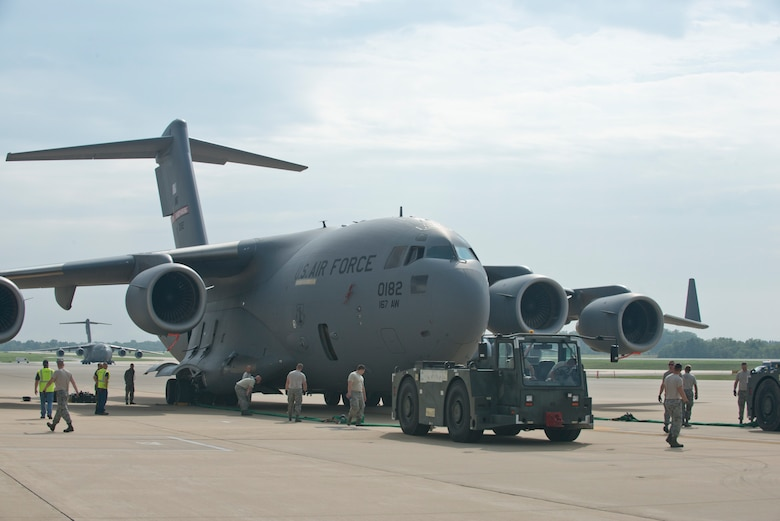 Maintainers prepare to tow a C-17 during a Crashed, Damaged or Disabled Aircraft Recovery training event at the 167th Airlift Wing, Aug 6. The training event coordinated by the wing's Repair and Reclamation Shop and Boeing representatives. (U.S. National Guard photo by Tech. Sgt. Michael Dickson)