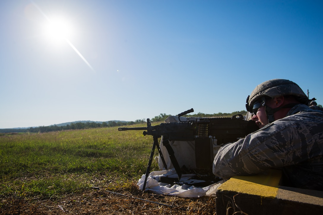 Staff Sgt. Phillip Courtney, 137th Security Forces Squadron Airman, fires an M249 during heavy weapons training at Camp Gruber Training Center near Braggs, Okla., Aug. 3, 2016.  Approximately 40 members of the 137 SFS completed annual training from July 29 to Aug, 5, 2016. Airmen participated in extensive training exercises including close combat, weapons, military operations on urban terrain and navigation. (U.S. Air National Guard photo by Senior Airman Tyler Woodward/Released)