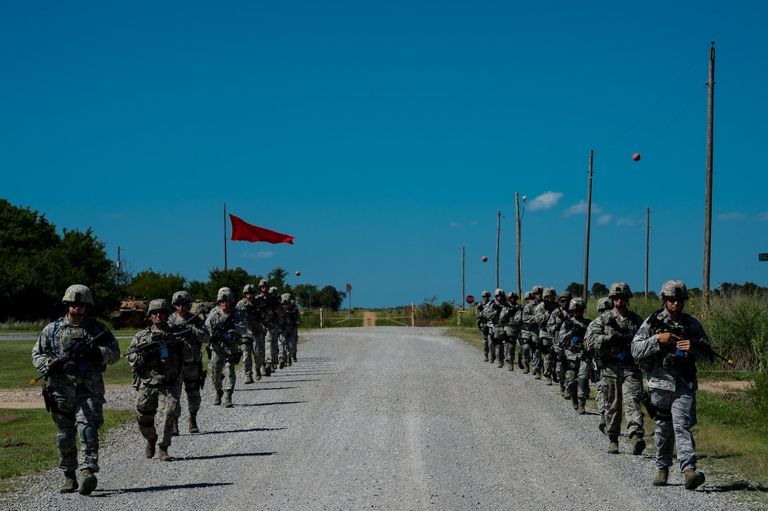 Airmen with the 137th Security Forces Squadron walk in formation at Camp Gruber Training Center near Braggs, Okla., Aug. 3, 2016.  Approximately 40 members of the 137 SFS completed annual training from July 29 to Aug, 5, 2016. Airmen participated in extensive training exercises including close combat, weapons, military operations on urban terrain and navigation. (U.S. Air National Guard photo by Senior Airman Tyler Woodward/Released)