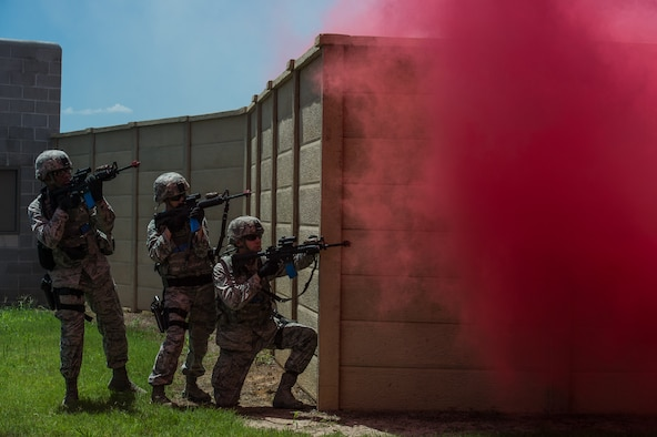 Airmen with the 137th Security Forces Squadron engage a target at Camp Gruber Training Center near Braggs, Okla., Aug. 3, 2016.  Approximately 40 members of the 137 SFS completed annual training from July 29 to Aug, 5, 2016. Airmen participated in extensive training exercises including close combat, weapons, military operations on urban terrain and navigation. (U.S. Air National Guard photo by Senior Airman Tyler Woodward/Released)