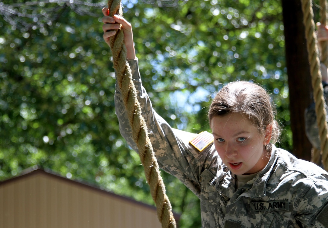 The ropes are tough! A Cadet Initial Entry Training (CIET) candidate tries the rope climb to The Tough One on the confidence course during Cadet Summer Training (CST16), at Ft. Knox, Kentucky, June 9. (U.S. Army Reserve photo by Sgt. Karen Sampson/ Released)