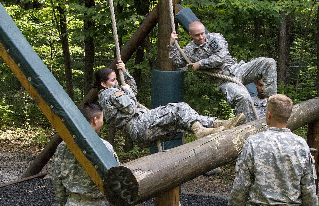 An Army Reserve instructor from Task Force Wolf grades Cadet Initial Entry Training (CIET) candidates performing the Swing, Stop and Jump obstacle on the confidence course at U.S. Army Cadet Command during Cadet Summer Training (CST16), Ft. Knox, Kentucky, June 18. (U.S. Army Reserve photo by Sgt. Karen Sampson/ Released)