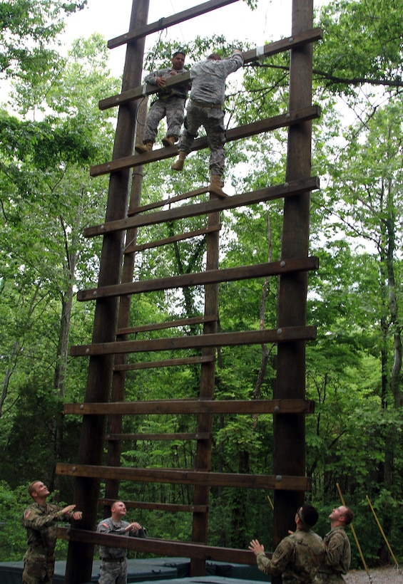 Army Reserve instructors from Task Force Wolf mentor Cadet Initial Entry Training (CIET) candidates on the confidence course at U.S. Army Cadet Command. A Cadet initiates The Ladder during Cadet Summer Training (CST16), at Ft. Knox, Kentucky, June 10. (U.S. Army Reserve photo by Sgt. Karen Sampson/ Released)