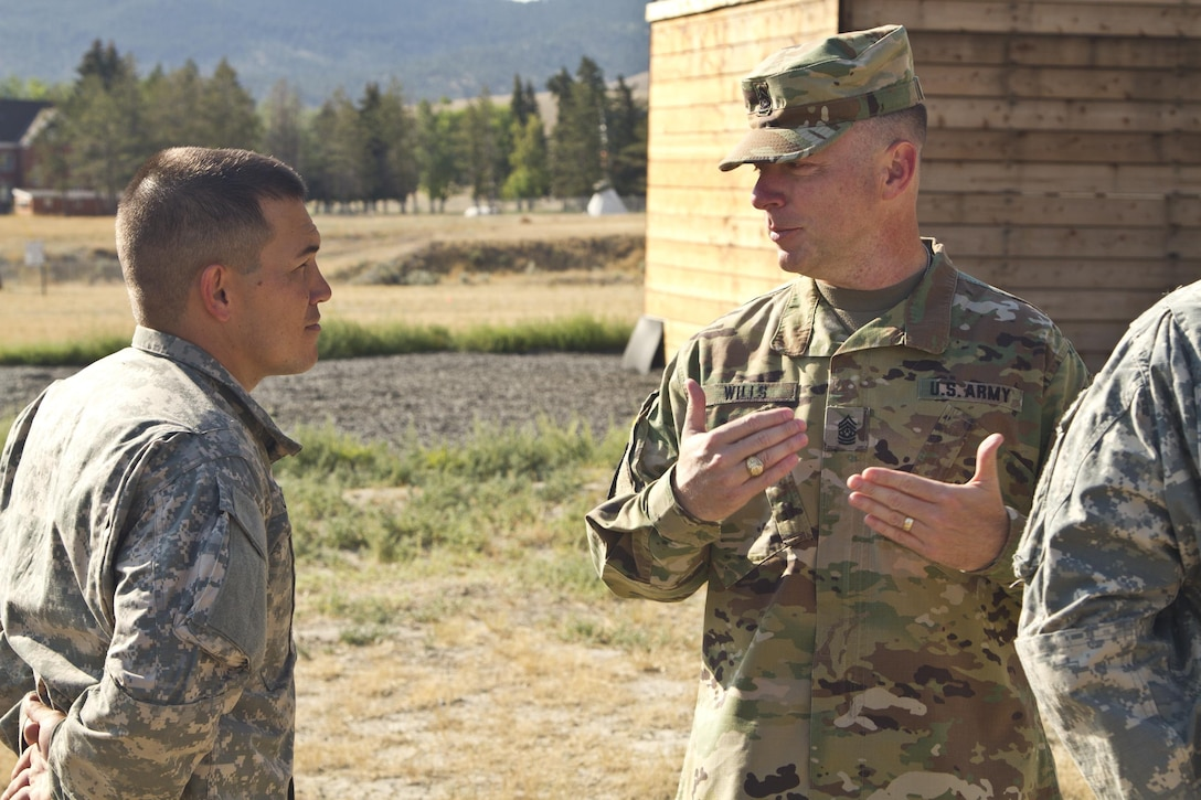 U.S. Army Reserve Command, Command Sergeant Major (Interim), Command Sgt. Maj. James P. Wills speaks with Spc. Michael S. Orozco, USARC 2016 Best Warrior winner in the Soldier category after an obstacle course training at Fort Harrison, MT, August 5, 2016. The USARC BWC winners from the noncommissioned officer and Soldier category are going through rigorous training, leading up to their appearance at Fort A.P. Hill later this year for the Department of Army BWC. (U.S. Army Reserve photo by  Brian Godette, USARC Public Affairs)
