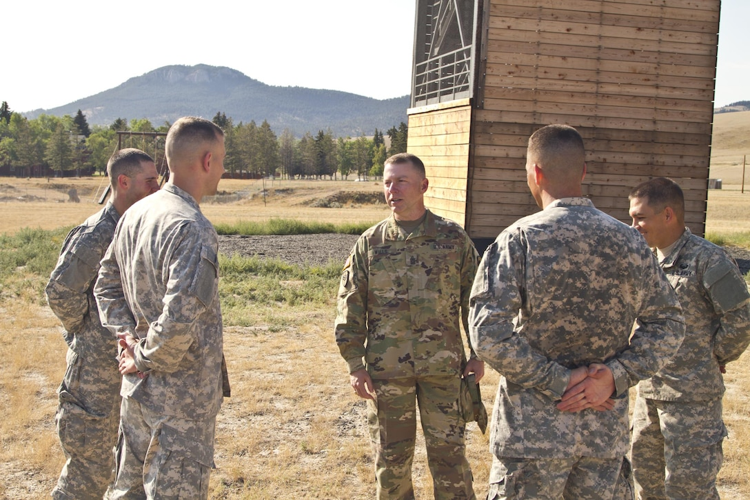 U.S. Army Reserve Command, Command Sergeant Major (Interim), Command Sgt. Maj. James P. Wills speaks with the USARC Best Warrior winners and runner-ups from the 2016 BWC competition after an obstacle course training at Fort Harrison, MT, August 5, 2016. The USARC BWC winners from the noncommissioned officer and Soldier category are going through rigorous training, leading up to their appearance at Fort A.P. Hill later this year for the Department of Army BWC. (U.S. Army Reserve photo by  Brian Godette, USARC Public Affairs)