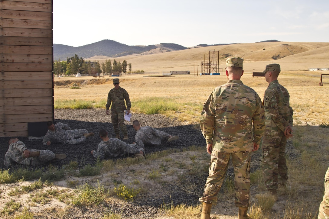 U.S. Army Reserve Command, Command Sergeant Major (Interim), Command Sgt. Maj. James P. Wills watches on as the USARC Best Warrior winners and runner-ups from the 2016 BWC competition stretch after an obstacle course training at Fort Harrison, MT, August 5, 2016. The USARC BWC winners from the noncommissioned officer and Soldier category are going through rigorous training, leading up to their appearance at Fort A.P. Hill later this year for the Department of Army BWC. (U.S. Army Reserve photo by  Brian Godette, USARC Public Affairs)