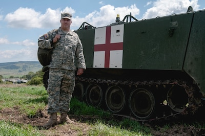 Army Staff Sgt. Brad Foster, a combat medic with the Oregon Army National Guard's Headquarters and Headquarters Company, 3rd Battalion, 116th Heavy Brigade Combat Team from Pendleton, Ore., is deployed to the Romanian Land Forces Combat Training Center in Cincu, Romania, for Exercise Saber Guardian 16, Aug. 3, 2016. Army photo by Spc. Timothy Jackson