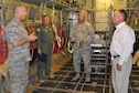 Col. David Post (right), commander of the 910th Maintenance Group, based here, talks about aircraft maintenance operations with U.S. Congressman David Joyce (right) of Ohio's 14th district on the cargo deck of a C-130H Hercules aircraft in a hangar here, August 4, 2016. 910th Operations Group Commander Col. Bill Phillips (middle left) and 910th Mission Support Group Commander Col. Donald Wren listen to Post's briefing. They also had the opportunity to talk with Joyce about their respective group's missions. The congressman visited YARS to learn more about the wing's capabilities and the installation's features firsthand as well as meet some of the Citizen Airmen assigned here. (U.S. Air Force photo/Master Sgt. Bob Barko Jr.)