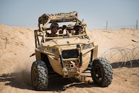 Marines with Kilo company, 3rd Battalion, 5th Marine Regiment, rush to provide support for other Marines in a MRZR at Marine Corps Air Ground Combat Center Twentynine Palms, Calif., July 31, 2016. The system was built by the Marine Corps Warfighting Laboratory (MCWL), which to assist Marines. The lab is conducting a Marine Air-Ground Task Force Integrated Experiment (MIX-16) in conjunction with Rim of the Pacific (RIMPAC-16) to explore new gear and assess its capabilities for potential future use. MCWL identifies possible challenges of the future, develops new warfighting concepts, and tests new ideas to help develop equipment that meets the challenges of the future operating environment.