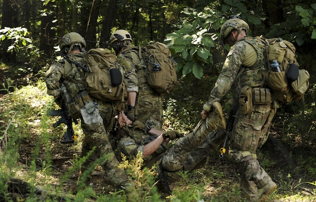 Explosive ordnance disposal (EOD) team members with the 509th Civil Engineer Squadron perform a medical evacuation during the Operation Thunder Weasel exercise at the Truman Lake National Guard Training Site, Mo., July 27, 2016. The EOD team was tested on their ability to treat a patient and evacuate them to a helicopter landing zone. (U.S. Air Force photo by Senior Airman Danielle Quilla)