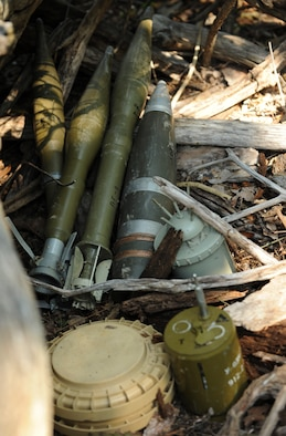 Unexploded ordnance items are hidden during the Operation Thunder Weasel exercise at the Truman Lake National Guard Training Site, Mo., July 27, 2016. Explosive ordnance disposal team members were tasked to locate, identify and dispose of the unexploded ordnance in support of their mission. (U.S. Air Force photo by Senior Airman Danielle Quilla)