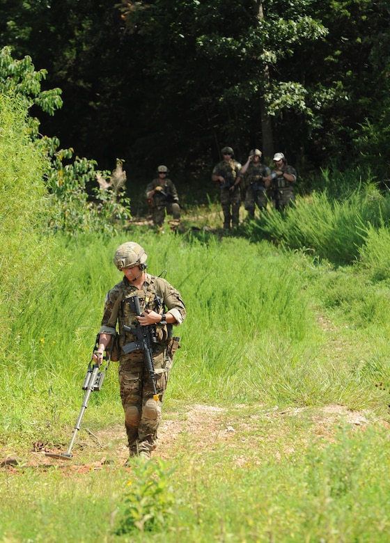 U.S. Air Force Senior Airman Conner Walsh, an explosive ordnance disposal team member assigned to the 509th Civil Engineer Squadron, clears a safe path during the Operation Thunder Weasel exercise at the Truman Lake National Guard Training Site, Mo., July 27, 2016. Teams were required to clear a safe path in order to locate and render safe any improvised explosive devices. (U.S. Air Force photo by Senior Airman Danielle Quilla)