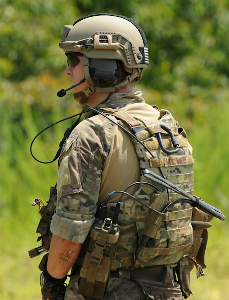 U.S. Air Force Airman 1st Class Tyler McConnell, an explosive ordnance disposal (EOD) team member assigned to the 509th Civil Engineer Squadron, radios in for updates during the Operation Thunder Weasel exercise  at the Truman Lake National Guard Training Site, Mo., July 27, 2016.  The EOD members utilized their attached support element to confirm the location of a weapons cache. (U.S. Air Force photo by Senior Airman Danielle Quilla)