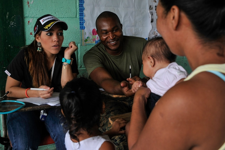 U.S. Navy Petty Officer 3rd Class Mercedes Macintosh, Special Purpose Marine Air-Ground Task Force hospital corpsman, smiles at a baby during a Medical Readiness Training Exercise operation consultation in Trujillo, Honduras, July 29, 2016. While MEDRETEs greatly help the local populations where they are conducted, the service members executing the operations also receive valuable medical training and experience that comes from operating in remote and/or austere environments. (U.S. Air Force photo by Staff Sgt. Siuta B. Ika)