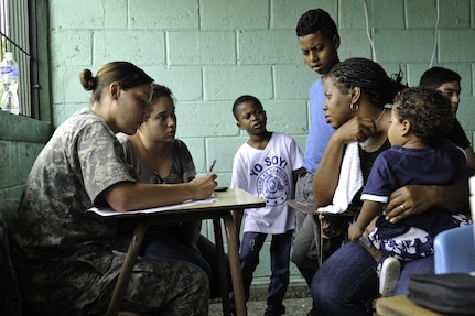 U.S. Army Spc. Lindsay Thompson, Joint Task Force-Bravo Medical Element medic, fills out paperwork during a Medical Readiness Training Exercise operation consultation in Trujillo, Honduras, July 29, 2016. U.S. military personnel from JTF-Bravo have been conducting MEDRETEs since 1993 and have treated more than 326,000 medical patients. (U.S. Air Force photo by Staff Sgt. Siuta B. Ika)
