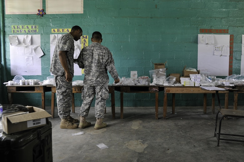 U.S. Army Spc. Joshua Miller, Joint Task Force-Bravo Medical Element medical logistics specialist, and Sgt. Jeffry Gomez, JTF-Bravo MEDEL dental technician, fulfill prescription orders during a Medical Readiness Training Exercise operation in Trujillo, Honduras, July 29, 2016. During MEDRETEs, personnel from every section of MEDEL come together to help accomplish the mission of delivering medical care in austere conditions, promoting diplomatic relations between the U.S. and host nations in Central America, and providing humanitarian and civic assistance via a long-term proactive program. (U.S. Air Force photo by Staff Sgt. Siuta B. Ika)