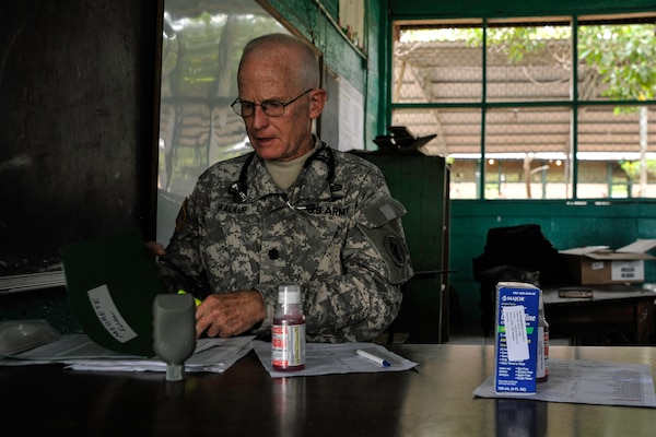 U.S. Army Lt. Col. (Dr.) Robert Walkup, Joint Task Force-Bravo Medical Element healthcare provider, reviews medication administration forms during a Medical Readiness Training Exercise operation in Trujillo, Honduras, July 29, 2016. During MEDRETEs, personnel from every section of MEDEL come together to help accomplish the mission of delivering medical care in austere conditions, promoting diplomatic relations between the U.S. and host nations in Central America, and providing humanitarian and civic assistance via a long-term proactive program. (U.S. Air Force photo by Staff Sgt. Siuta B. Ika)