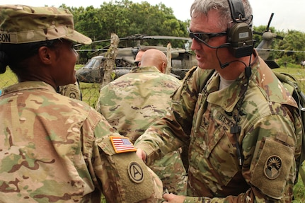 U.S. Army Capt. Summer Sampson, Medical Administrations Officer, says goodbye to U.S. Army Col. Brian Hughes, Commander of Joint Task Force-Bravo, after his tour of the school site where JTF-Bravo Medical Element personnel participated in a Medical Readiness Training Exercise in the village of La Boveda, Trujillo, July 29, 2016. Capt. Sampson was the officer in charge of this two-day MEDRETE, which began its planning process 90 days prior, and ultimately provided medical attention for a total of 1,072 patients of all ages. (U.S. Army photo by Maria Pinel)