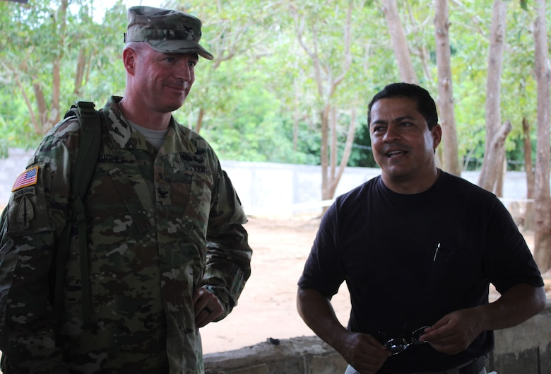 Dr. Wilmer Amador, Joint Task Force-Bravo Honduran Medical Liaison (right), stands next to U.S. Army Col. Brian Hughes, Joint Task Force-Bravo commander, as he explains the different services and provides a tour of the site for key leaders from both JTF-Bravo and Honduras, during a Medical Readiness Training Exercise in the village of La Boveda, Trujillo, July 29, 2016. As the LNO, Amador coordinates mostly with non-profit organizations such as the Ministry of Health, and also coordinates with the Honduran military, school teachers and school principals. (U.S. Army photo by Maria Pinel)