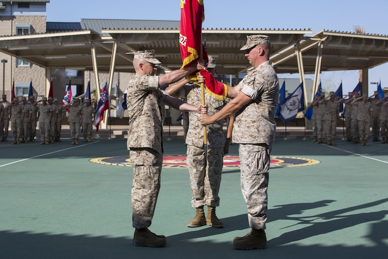 Marines with the Marine Corps Tactics and Operations Group bow their heads during the invocation as part of the unit's change of command ceremony at the Dunham Amphitheater aboard Marine Corps Air Ground Combat Center, Twentynine Palms, Calif., July 29, 2016. During the ceremony, Col. Craig Wonson, outgoing commanding officer, relinquished command to Col. Tim Barrick, oncoming commanding officer. (Official Marine Corps photo by Cpl. Thomas Mudd/Released)