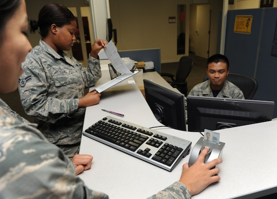 Airman Brenda Prudencio, 81st Force Support Squadron customer support technician, resets her common access card pin number with the assistance of Airmen 1st Class Cacinni Young and Jmb Baldonado, 81st FSS customer support technicians, at the Sablich Center Aug. 5, 2016, on Keesler Air Force Base, Miss. CAC pin reset machines have been placed at three locations: The Sablich Center, Room 125; the Keesler Medical Center, Room 4F102 and the Levitow Training Support Facility, Room 228. (U.S. Air Force photo by Kemberly Groue)