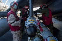 Marines from the 22nd Marine Expeditionary Unit (MEU), prepare an AV-8B Harrier II for launch on the flight deck of the amphibious assault ship USS Wasp (LHD 1) Aug. 1, 2016. The 22nd MEU is conducting precision air strikes in support of the Libyan Government of National Accord-aligned forces against Daesh targets in Sirte, Libya as part of Operation Odyssey Lightning.