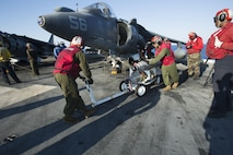 Marines with 22nd Marine Expeditionary Unit (MEU), prepare an AV-8B Harrier II for launch on the flight deck of the amphibious assault ship USS Wasp (LHD 1) Aug. 1, 2016. 22nd MEU, embarked on the Wasp is conducting precision air strikes in support of the Libyan Government of National Accord-aligned forces against Daesh targets in Sirte, Libya as part of Operation Odyssey Lightning.