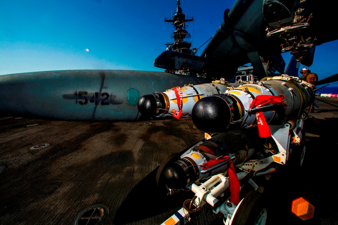 Marines with Marine Medium Tiltrotor Squadron 264 (Reinforced), 22nd Marine Expeditionary Unit (MEU), load ordnance on an AV-8B Harrier II on the flight deck of the amphibious assault ship USS Wasp (LHD-1) Aug. 2, 2016. At the request of the Libyan Government of National Accord (GNA), the 22nd MEU is conducting precision airstrikes against ISIL targets in Sirte, Libya, to support GNA-affiliated forces seeking to defeat ISIL in its primary stronghold in Libya.