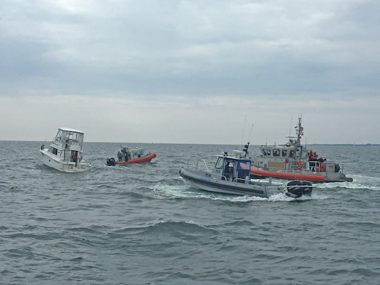 U.S. Coast Guard and other emergency vessels assist a small vessel in distress on the Chesapeake Bay after receiving the exact location of the distressed vessel from U.S. Army Corps of Engineers, Baltimore District's Survey Vessel LINTHICUM Sunday Aug. 7, 2016. LINTHICUM responded after being notified by a passing ship of a nearby flare while conducting a condition survey of the nearby Cape Henry Channel.