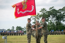 MARINE CORPS BASE CAMP LEJEUNE, N.C. – (Right to left) Major Gen. Joseph L. Osterman passes the Marine Corps colors to Maj. Gen. Carl E. Mundy III during a change of command ceremony aboard Marine Corps Base Camp Lejeune, N.C., July 26, 2016. The passing of the flag symbolizes Osterman relinquishing his responsibilities as the commanding general of U.S. Marine Corps Forces, Special Operations Command to Mundy. (U.S. Marine Corps photo by Cpl. Ryan C. Mains/ Released)