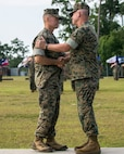MARINE CORPS BASE CAMP LEJEUNE, N.C. – Major Gen. Carl E. Mundy III, left, shakes hands with Maj. Gen. Joseph L. Osterman, during a change of command ceremony aboard Marine Corps Base Camp Lejeune, N.C., July 26, 2016. During the ceremony, Osterman relinquished his responsibilities as commanding general of U.S. Marine Corps Forces, Special Operations Command to Mundy. (U.S. Marine Corps photo by Cpl. Ryan C. Mains/ Released)