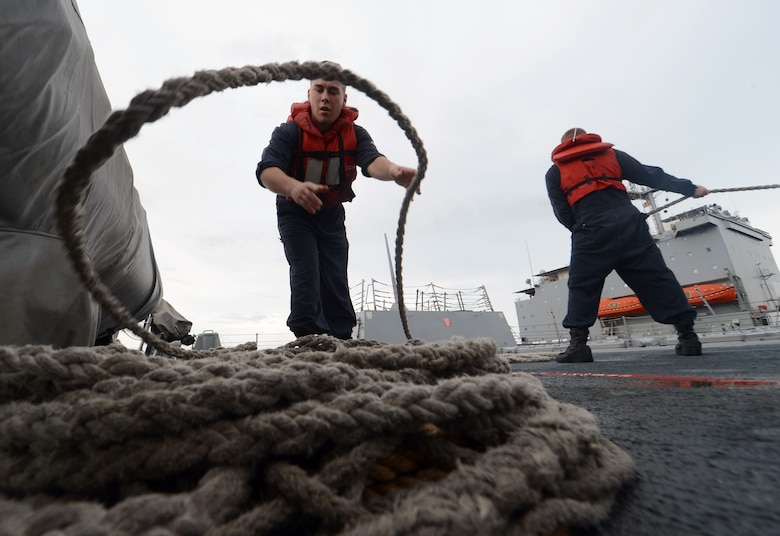 Gunner's Mate 2nd Class James Callison coils line aboard the guided-missile destroyer USS Momsen (DDG 92) during a replenishment-at-sea with the fleet replenishment oiler USNS Joshua Humphreys (T-AO 188), Aug. 8, 2016. The guided-missile destroyers USS Spruance (DDG 111), USS Decatur (DDG 73- and Momsen are deployed in support of maritime security and stability in the Indo-Asia Pacific as part of a U.S. 3rd Fleet Pacific Surface Action Group (PAC SAG) under Commander, Destroyer Squadron (CDS) 31.