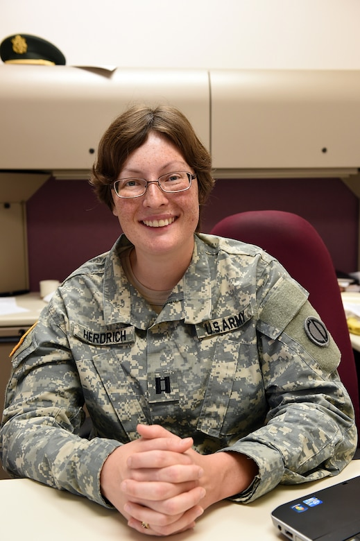 Army Reserve Capt. Jessica Herdrich, Trial Counsel, 85th Support Command, pauses for a photo during a battle assembly at the 85th Support Command. Herdrich is preparing for a yearlong deployment to Kuwait on a legal assistance mission to assist soldiers in the theater of operations. (U.S. Army photo by Spc. David Lietz/Released)